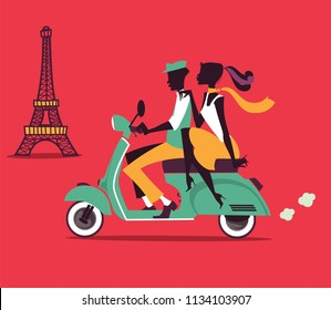 Couple silhouettes on scooter with Eifel Tower