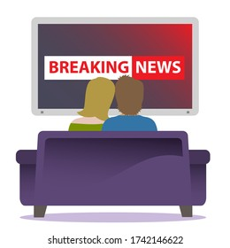 A couple sitting together on a cozy couch watching breaking news on TV.