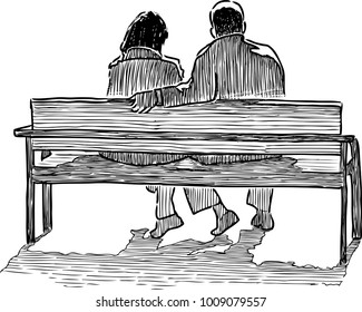 A couple of townspeople sitting on a park bench