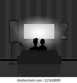 Couple watching movie on TV at night