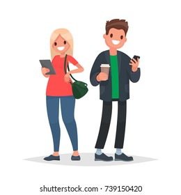 Couple of young people with gadgets. A man with a phone and a woman with a tablet. Vector illustration in a flat style