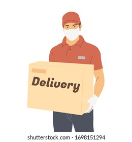 courier in face masks and gloves with a large box in his hands. Prevention of coronavirus, covid-19. Delivery of goods from an online store to your home during quarantine.