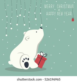 The cover design. Depicts a seated little polar bear with gift box. A garland of snow balls over a bear and the phrase merry Christmas and a happy New year on blue background.