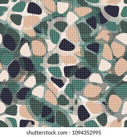 Covered with a transparent network of abstract seamless camouflage. A fashionable hodgepodge of color.