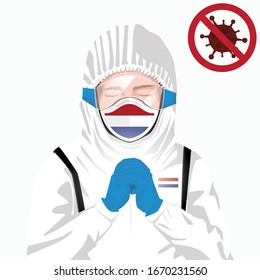 Covid-19 or Coronavirus concept. Dutch medical staff wearing mask in protective clothing and praying for against Covid-19 virus outbreak in Holland. Dutch man and Netherlands flag. Epidemic corona