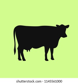 Cow black silhouette illustration isolated on green background