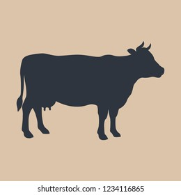 Cow sign. Cow black silhouette Isolated on beige background. Cattle symbol. Vector illustration
