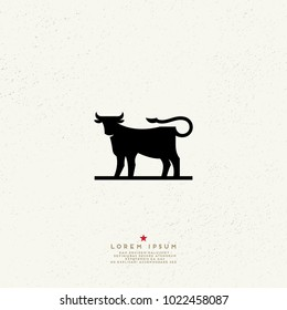 Cow silhouette logo.