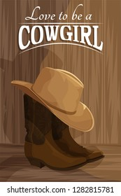 Cowboy boots and cowboy hat on a wooden background with copy space.