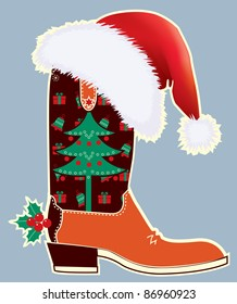 Cowboy christmas card with boot and Santa's red hat