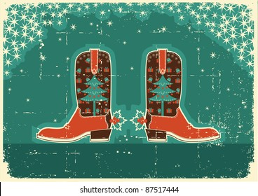 Cowboy christmas  card with boots and holiday decoration on old paper texture