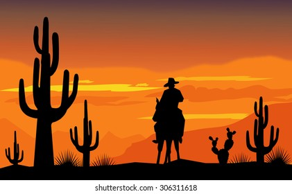 Cowboy and desert sunset