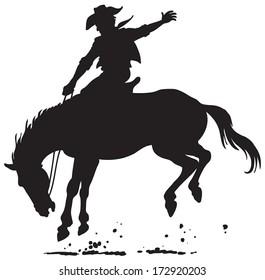A cowboy on horseback rides.