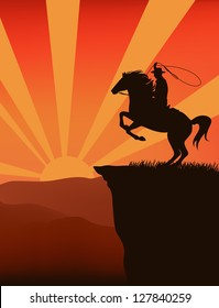 cowboy on top of mountain at sunset  - silhouette against sky with sun rays
