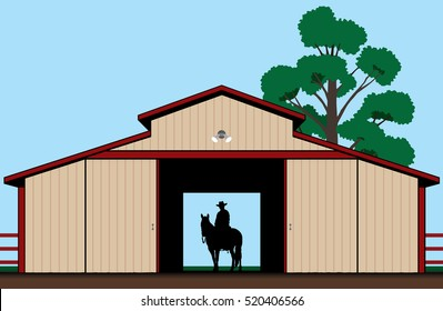 Cowboy is sitting astride his horse in the shadow of a barn