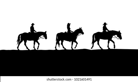 cowboys riding in prairie