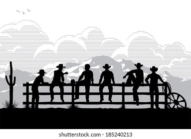 Cowboys sitting on fence