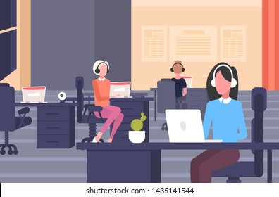 coworkers in headset female operators sitting at workplace desks call center concept co-working open space modern office interior flat horizontal full length