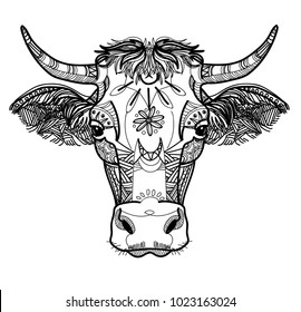The cow's head. A cow with big horns and fluffy ears. Drawing manually in vintage style. Meditative coloring. Coloring for children. Arrows, points, patterns, waves.