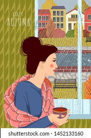 Cozy autumn. Cute flat vector vertical illustration of woman with a cup of tea looking out the window.. Outside the window is an autumn storm and rain against the background of the urban landscape.