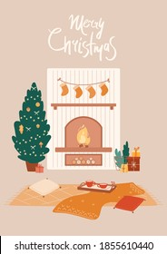 Cozy home interior with fireplace, Christmas tree, decorative garland with socks, gift boxes. Warm evening, blanket, pillows, tray with hot drinks. Greeting New Year card with lettering.