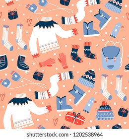 Cozy winter clothes and other stuff. Colored vector seamless pattern. Peach background