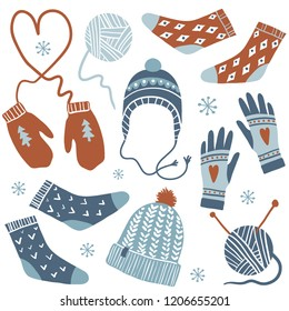 Cozy winter. Vector set of cute winter accessories: socks, hats, mittens, knitting tools and yarn. Hand draw collection of clothes with ornaments. New Year and winter holiday symbols