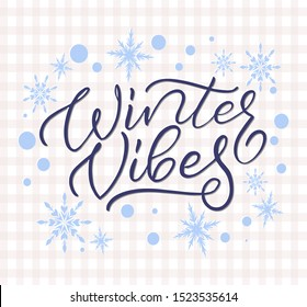 Cozy winter vibes vector hand drawn brush calligraphy illustration. Hand lettering text with snow flakes on checkered background. Useable as greeting card, print, banner, poster,  cover.