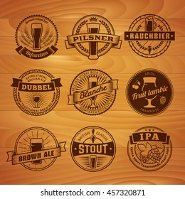 Craft beer labels. Traditional german, belgian and british beer styles. Weissbier, pilsner, rauchbier, dubbel, blanche, fruit lambic, brown ale, stout and IPA. Vintage emblems on a wooden background