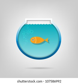 Creative aquarium with a small goldfish