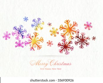 Creative colorful snowflakes on shiny background for Merry Christmas and Happy New Year celebration.