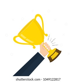 Creative concept on businessman hand holding gold cup award icon. Winner prize goblet. First place champion trophy reward. Success and business goals Vector illustration