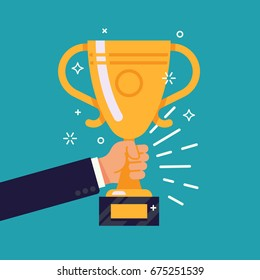 Creative flat design vector concept on businessman hand holding gold cup award icon. Winner prize goblet. First place champion trophy reward. Success and business goals