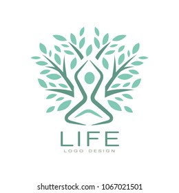 Creative flat vector life logo with abstract human silhouette in yoga pose and green leaves of tree. Harmony with nature. Healthy lifestyle