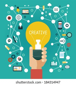 Creative network concept. Human hand with a bulb surrounded by media icons