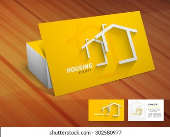 Construction business card stock images royalty free images creative shiny business or visiting card design in yellow color on wooden background for housing society reheart Gallery