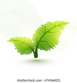 Creative shiny green leaves for Ecology concept.