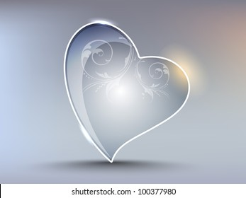 Creative shiny heart shape with elegant floral design and reflection effect, isolated on grey. EPS 10. Vector illustration.