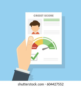 Credit score document. Man holds the aper with foto and personal information about credit and index.