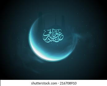 Crescent moon with arabic islamic calligraphy of text Eid-Ul-Adha on blue background for Muslim community festival of sacrifice celebrations.