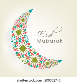 Crescent moon decorated with colourful flowers on beige background for muslim community festival Eid Mubarak celebrations.