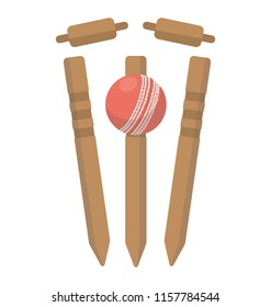A cricket ball hitting bowling over wicket stumps