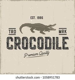 Crocodile retro label isolated on kraft paper.Vector illustration.