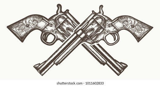 Crossed guns tattoo and t-shirt design. Wild west weapon hand drawn vector engraved style