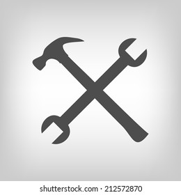Crossed hammer and spanner. Tools icon in grey color, repair symbol
