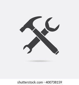 Crossed Hammer and Wrench Icon. Repairing icon with shadow.
