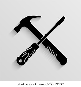 Crossed screwdriver and hammer vector icon with  shadow