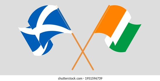 Crossed and waving flags of Scotland and Republic of Ivory Coas