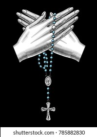 Crossed woman's hand with catholic prayer beads on black. Vintage engraving stylized drawing. Vector illustration