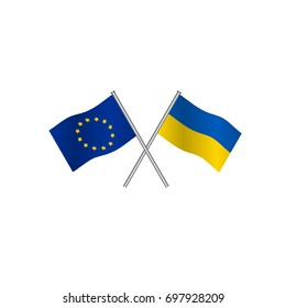 Crossing flags of Europe Union and Ukraine, candidate to entry in EU. Concept of cooperation between the two countries